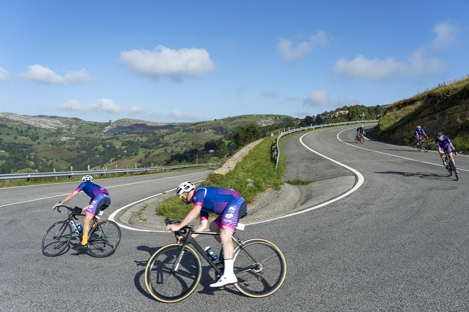 London to Monaco riders speeding down of a climb in Spain
