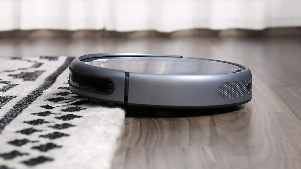 Robotic vacuum moving from from hard floors to carpet.