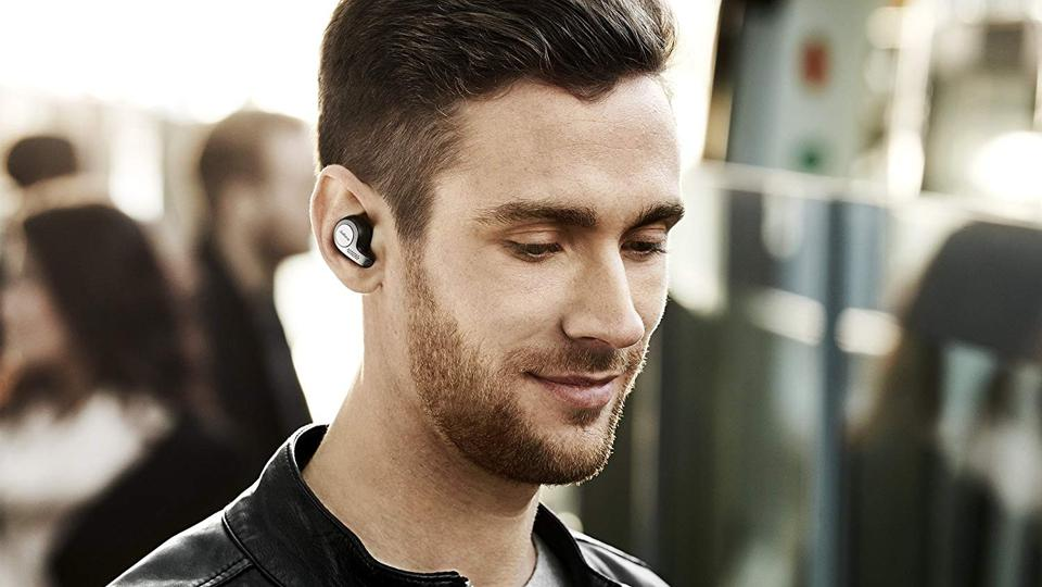 Person wearing Jabra Elite 65t true wireless headphones.