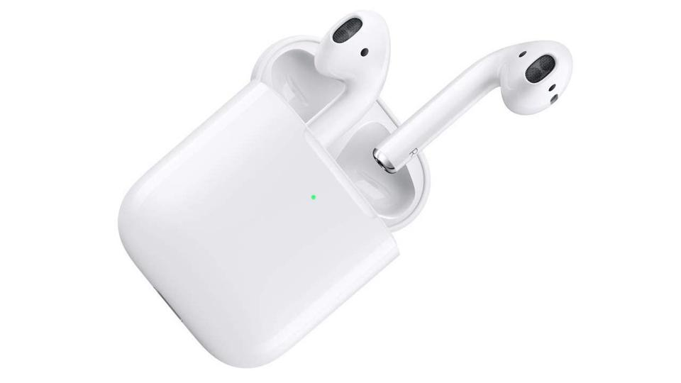 White Apple AirPods coming out of Wireless Charging Case.