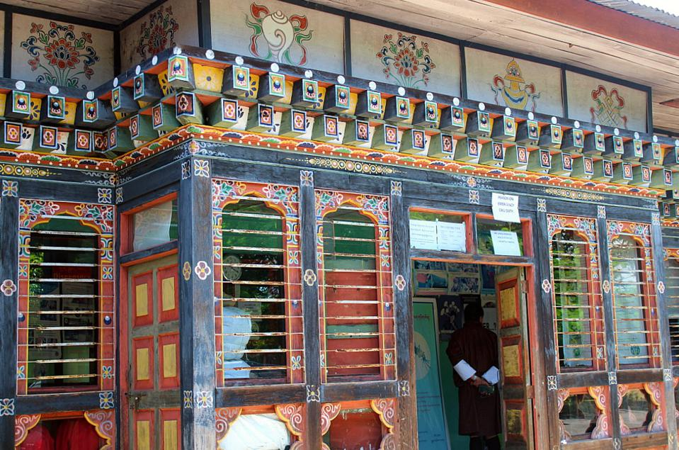 Red, green and blue building with floral motifs