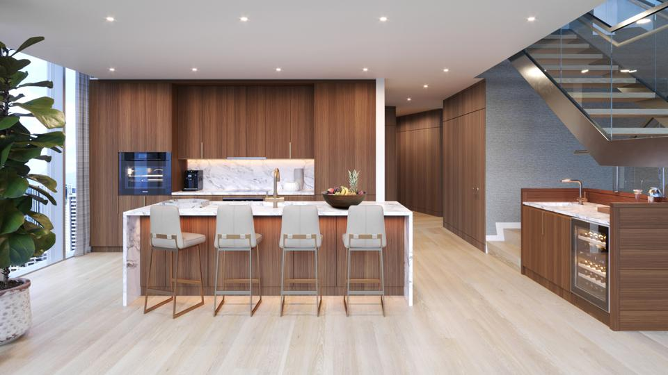 Diamond Back Club Penthouses feature kitchens equipped with Miele appliances, including wall ovens and wine refrigerators.