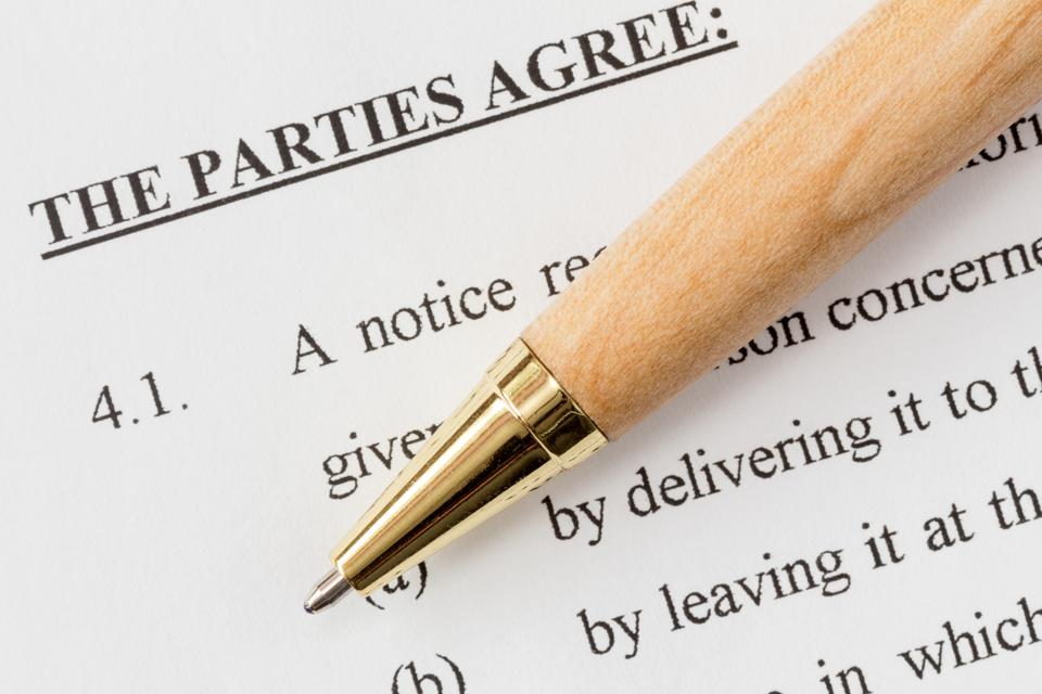 Pen over a printed agreement