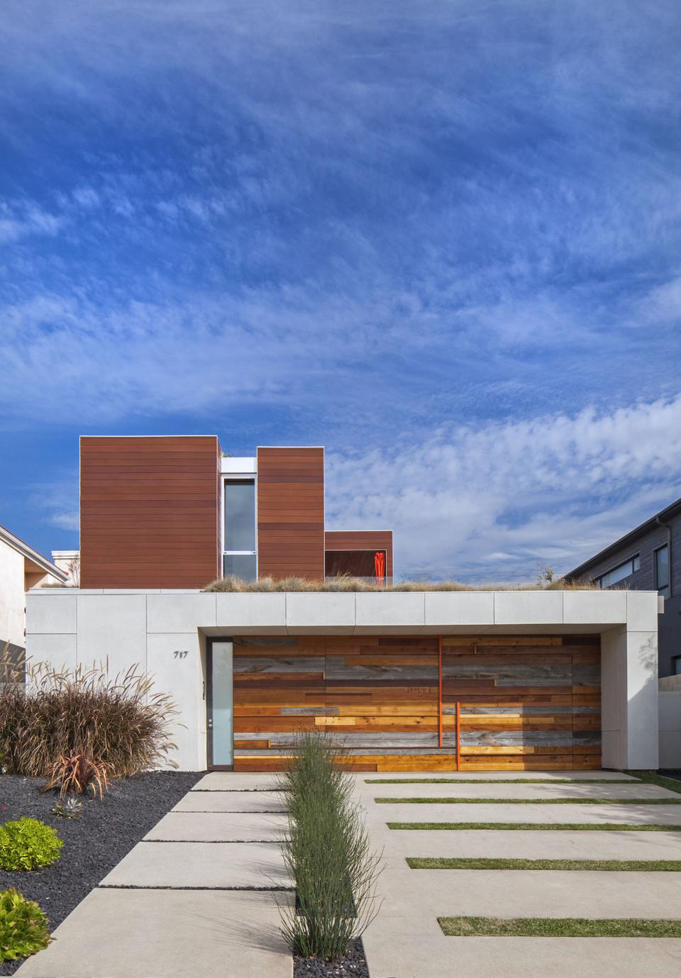 Using scrap wood and quartz, Minarc Architects designed a garage door that is a beautiful art piece and focal point of this Santa Monica house.