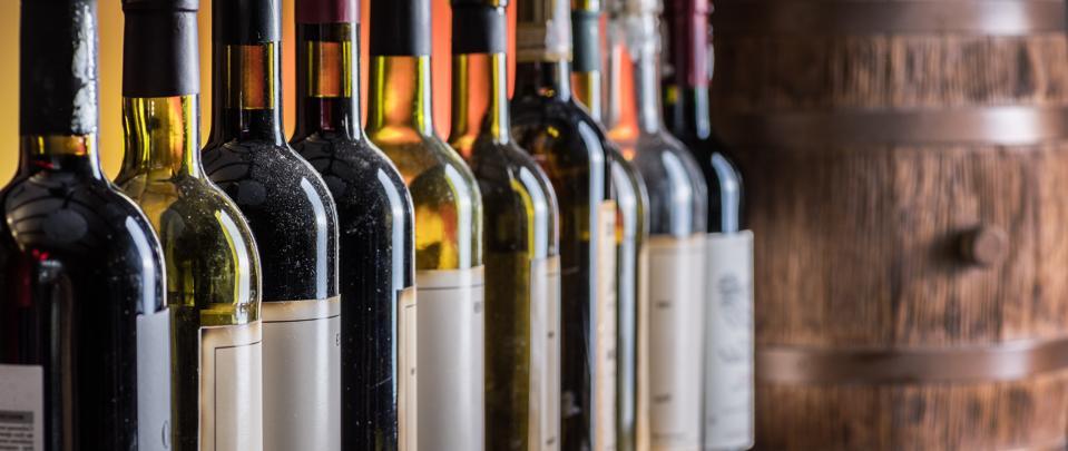 Wine bottles in row.
