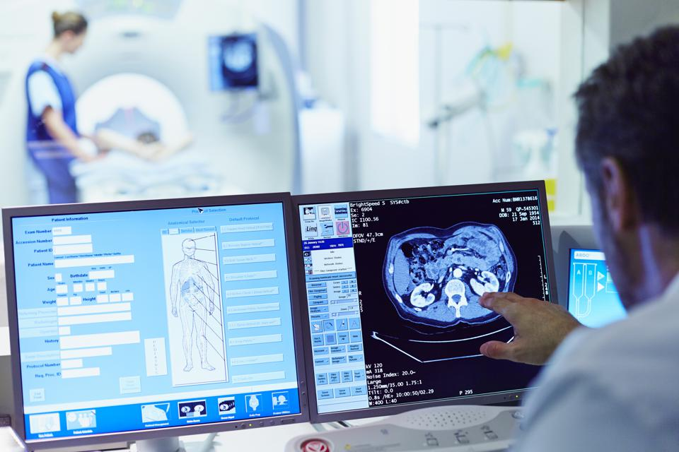 Doctor running CT scan from control room
