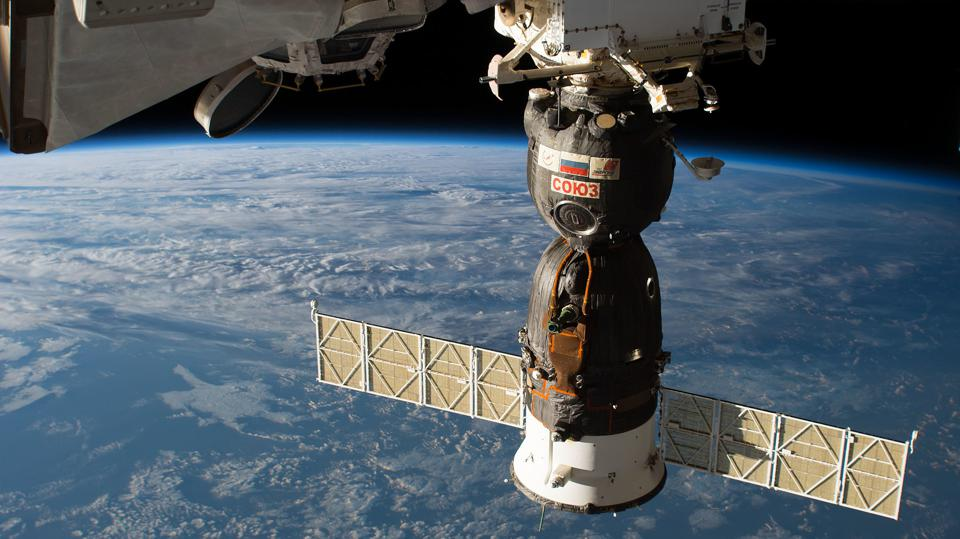 The Soyuz MS-09 spacecraft is pictured docked to the Rassvet module on the Russian segment of the International Space Station as the orbital complex was flying 253 miles above the North Pacific Ocean south of Alaska's Aleutian Islands.