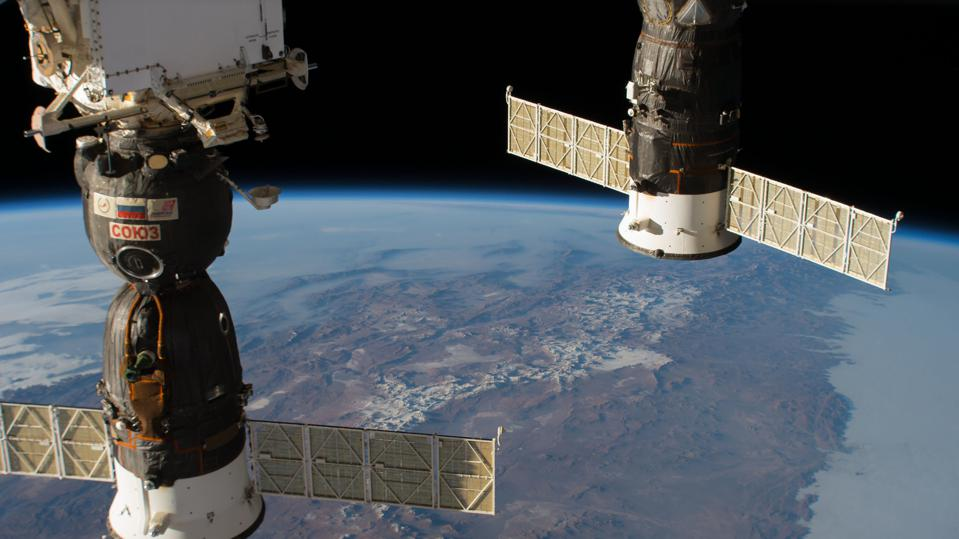 Two docked Russian spacecraft on the ISS, the Soyuz MS-09 crew ship and the Progress 70 resupply ship, pictured above the Andes mountain range and the South American continent on Aug. 15, 2018.