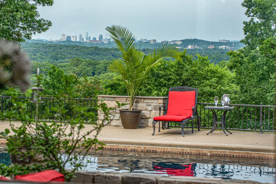 The property has expansive views and Downtown Nashville can be seen in the distance.