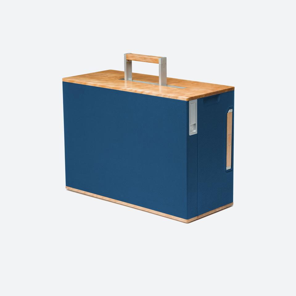 Bonaventure luggage from Charles Simon are crafted using Canadian wood and French leather on carbon fiber and aluminum.