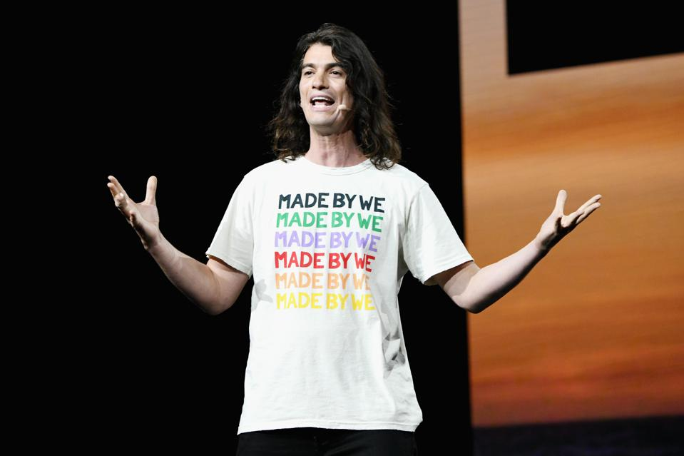 Adam Neumann speaks onstage