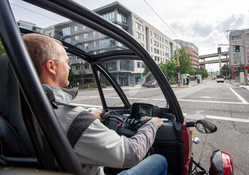 CEO Frohnmayer at the controls of his personal Arcimoto FUV, or Fun Utility Vehicle.