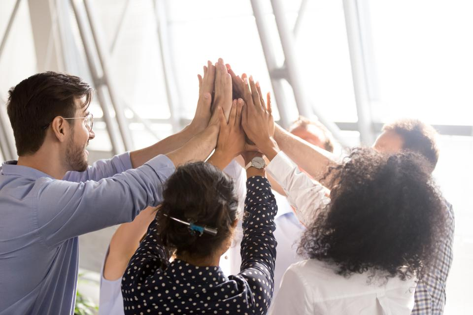 Diverse business team office workers group giving high five together