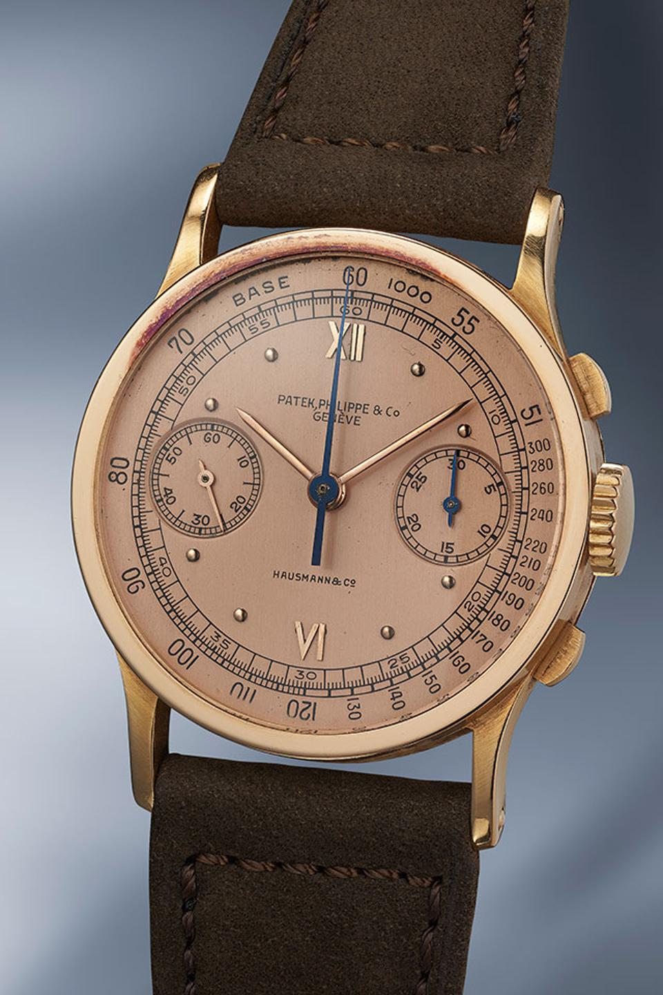 The only publicly known pink gold Patek Philippe chronograph reference 533 with a pink dial that is signed by Italian retailer Hausmann.