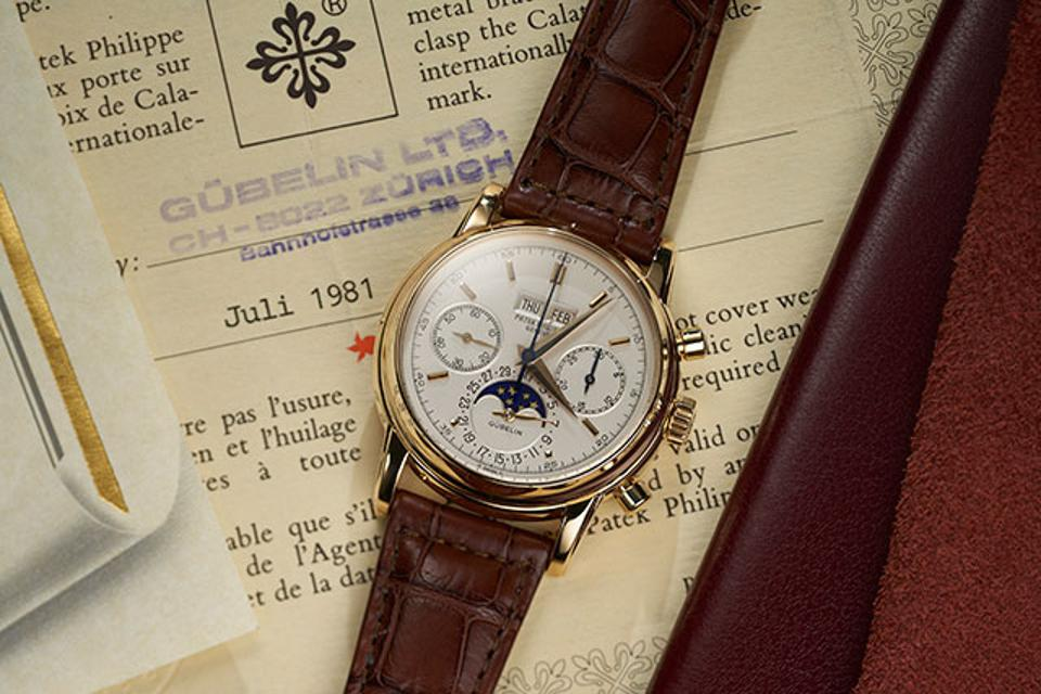 A yellow gold Patek Philippe perpetual calendar chronograph Reference 2499/100 retailed in Switzerland by Gübelin, with original certificate.