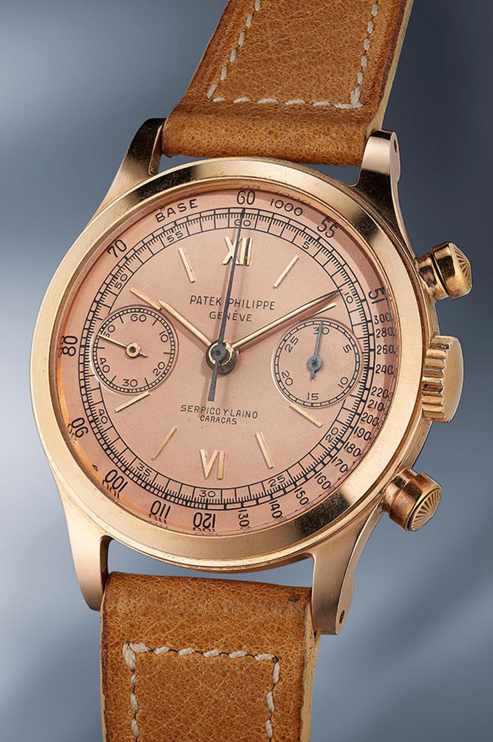 A rare pink gold Patek Philippe chronograph Reference 1463 with pink dial made in 1952 and retailed by Serpico y Laino.