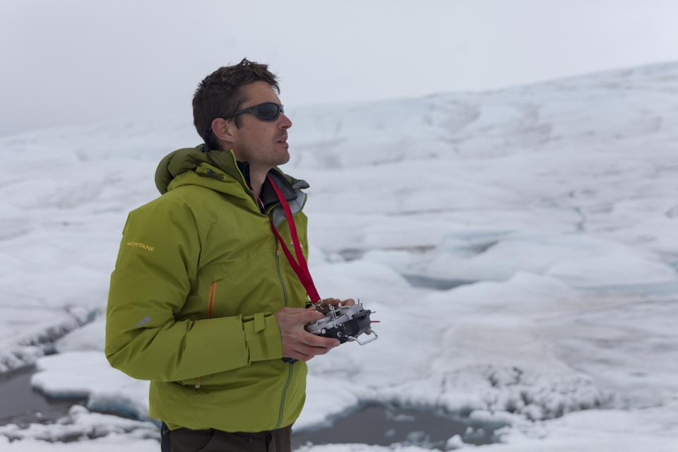 Polar scientist Joseph Cook collecting data on the ice sheets