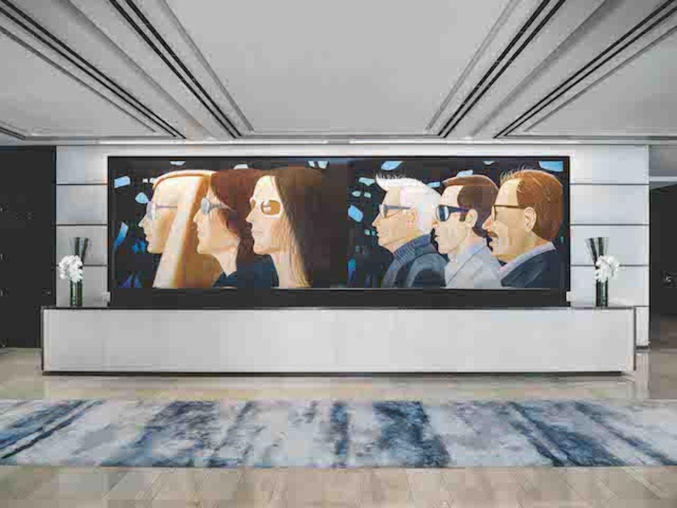 Katz mural behind the reception desk at The Langham New York