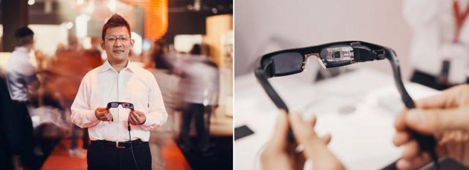 "Left: ""This is totally different from conventional head-mounted displays because they have screens that require focusing and cause eye fatigue,"" says Nori Miyauchi, general manager of regulatory affairs at QD Laser. Right: The RETISSA Display projects images onto the retina."