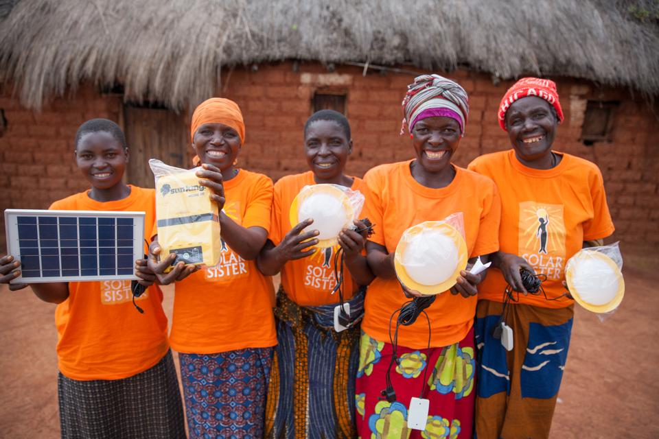 Women entrepreneurs with solar powered lights