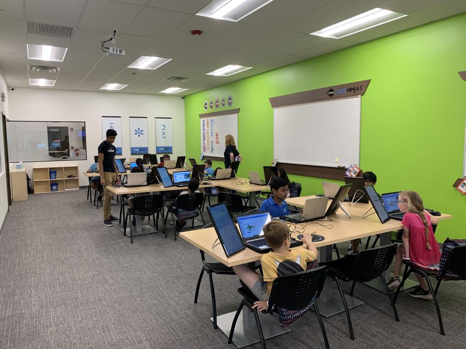 Kids learning to code at the Code Ninjas learning center in Long Grove, Illinois.