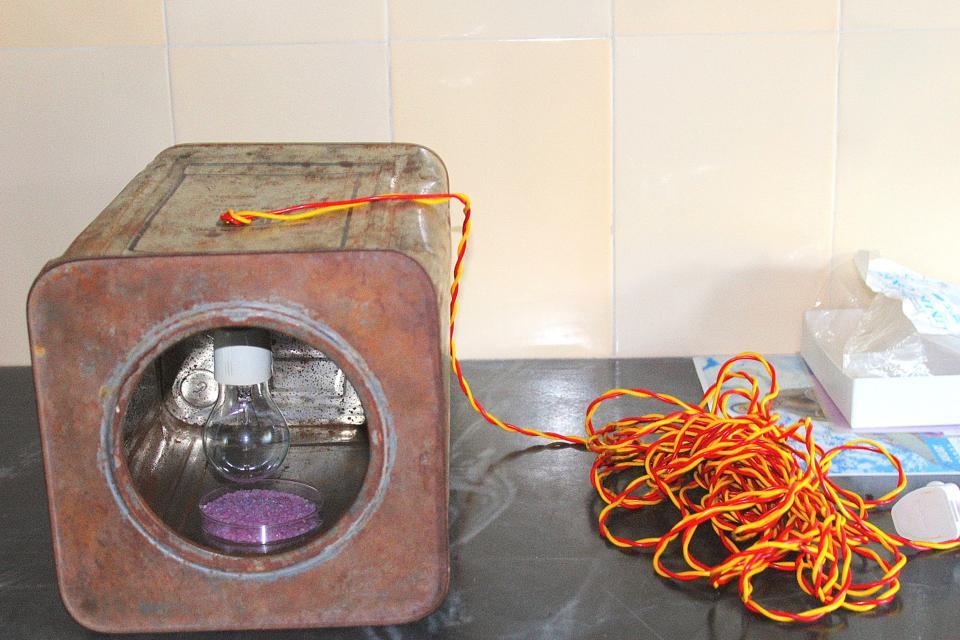 Rusty tin with light bulb