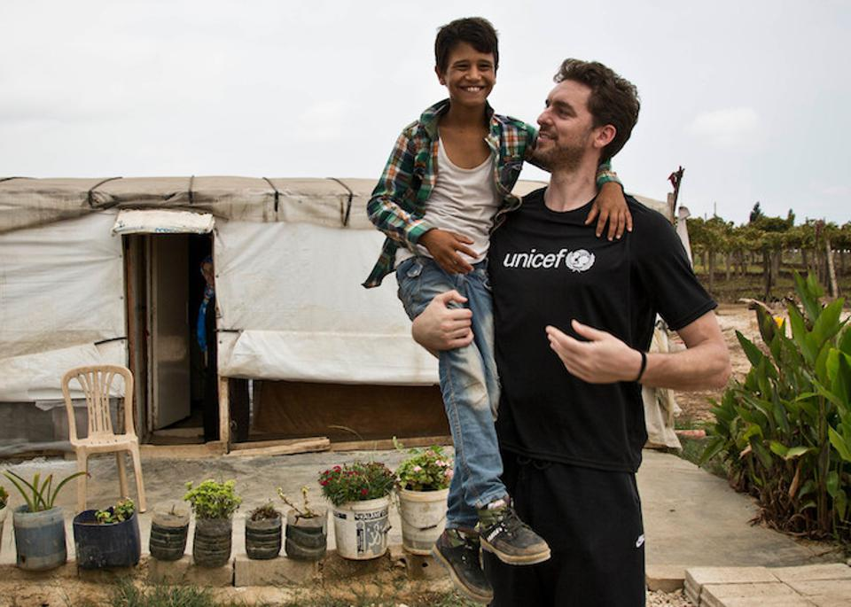 UNICEF Global Champion for Nutrition and Zero Childhood Obesity Pau Gasol plays with Hussein, an 11-year-old Syrian refugee, on a field visit to an informal settlement in Minyara, Lebanon in 2016.
