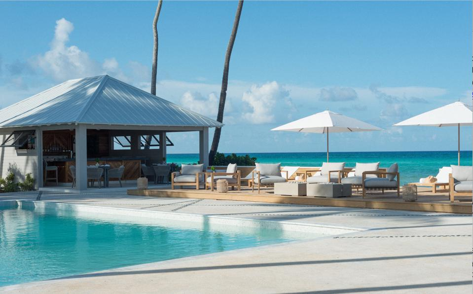 The shockingly blue Caribbean waters from the Caerula Mar hotel pool.