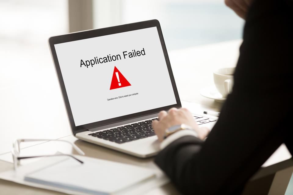 Application failed, businessman having problem with laptop, soft