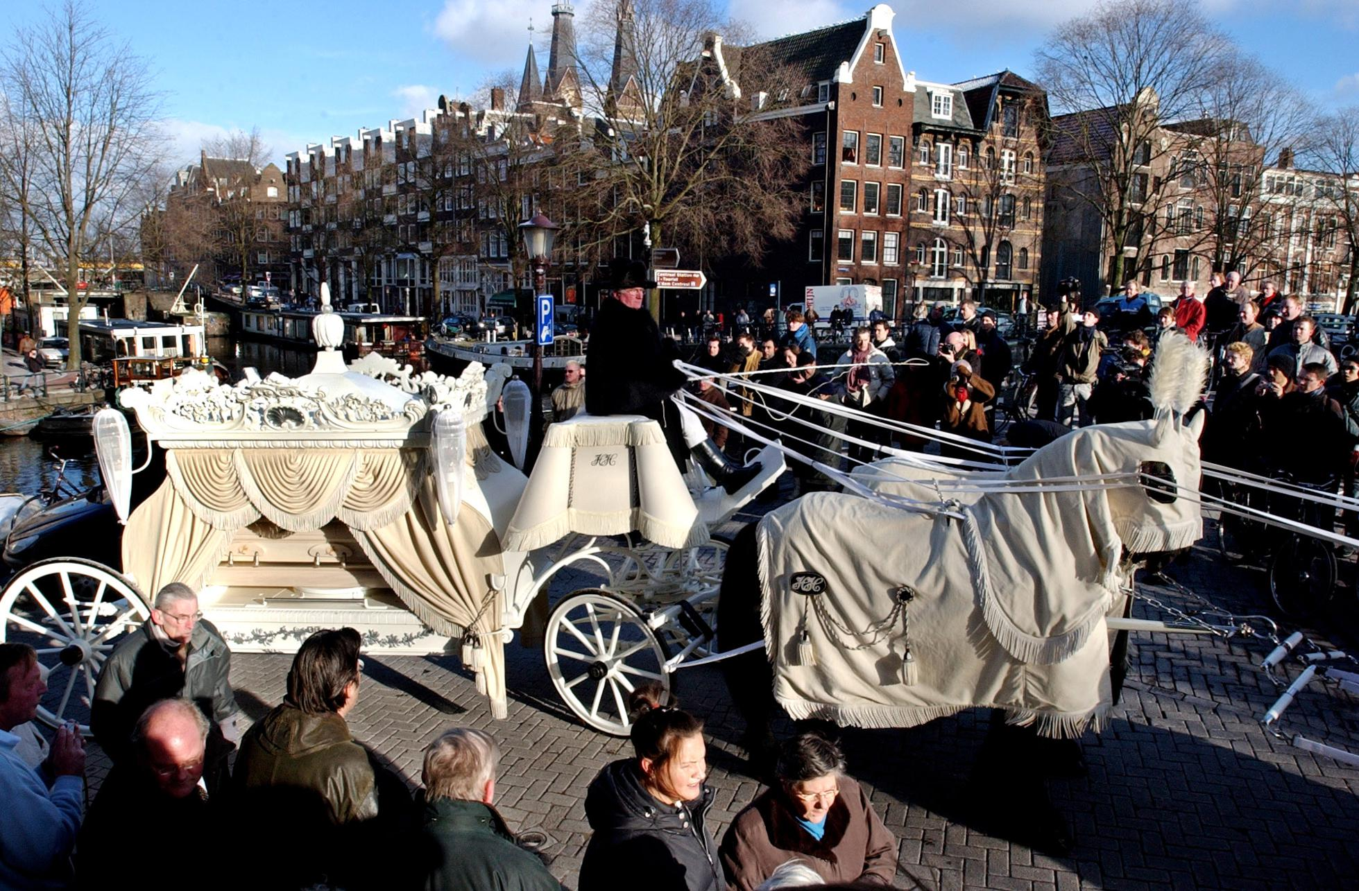 Cor van Hout's white  hearse was pulled by eight Frisian horses,