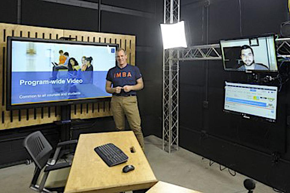 A live Internet class in one of five studios at the University of Illinois' Gies College of Business
