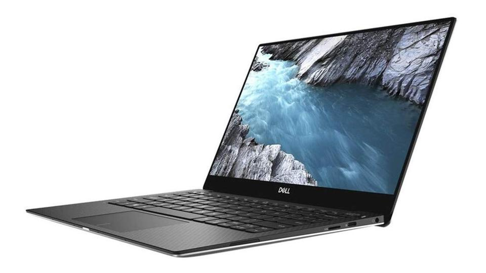 4K Dell XPS 13 laptop with black keyboard.