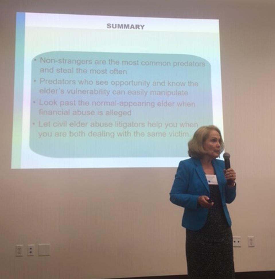 Carolyn Rosenblatt speaking at conference