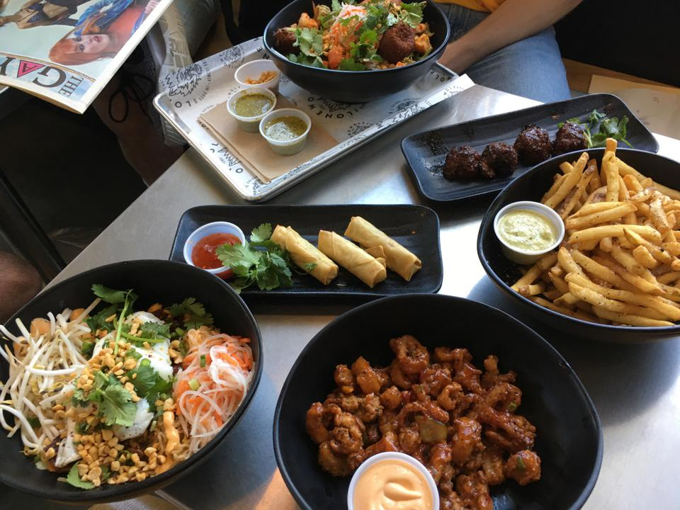 A spread of food at Lone Wolf Banh Mi