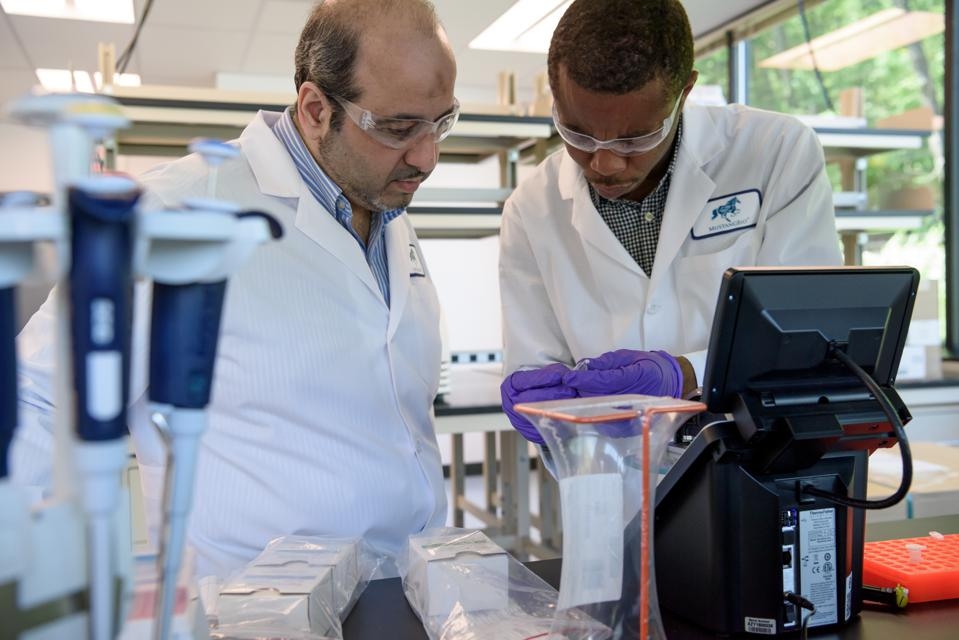 Mustang Bio Lab Manager Mohammed Ridha (left) and Analytical Development Scientist Kennedy Okechukwu (right).