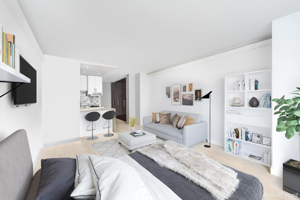 A studio apartment with gray and white decor.