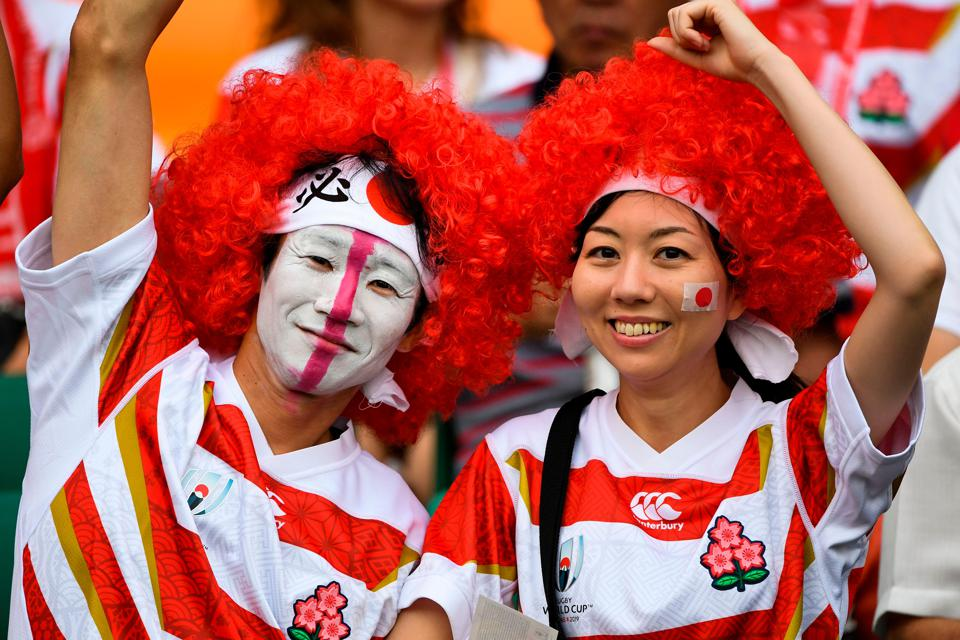 Japanese rugby fans cheer for their team.
