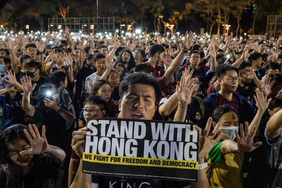 Pro-democracy football fans gather to form a human chain.