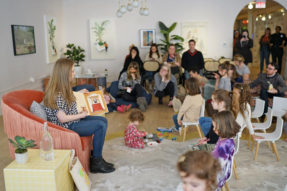 Chelsea Clinton reading her children's book to children at The Little Wing.