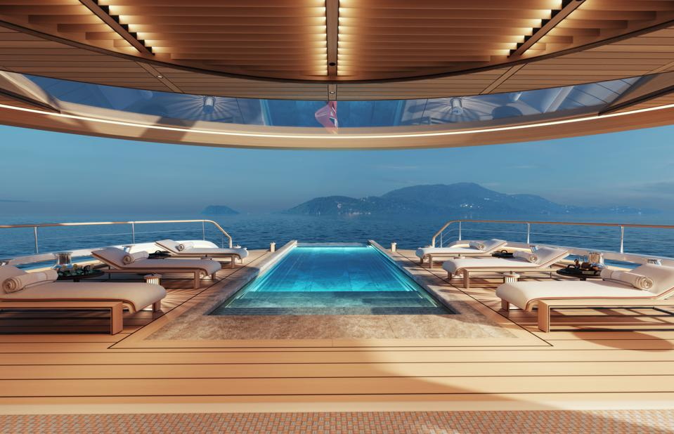 The hydrogen-powered superyacht Aqua features a massive beach deck pool and lounge.