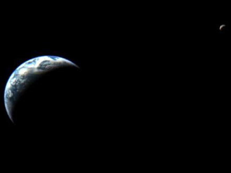 Color photo of a partially shadowed Earth, with a partially-shadowed Moon in the background, against the blackness of space.