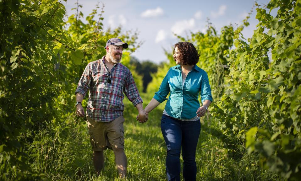 Brian Cadamatre and Nova McCune Cadamatre Walking the Vineyards in the Finger Lakes