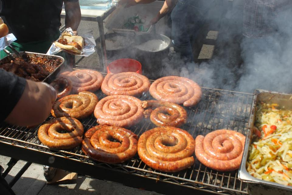 Roasted sausages are a staple at the Italian festivals.