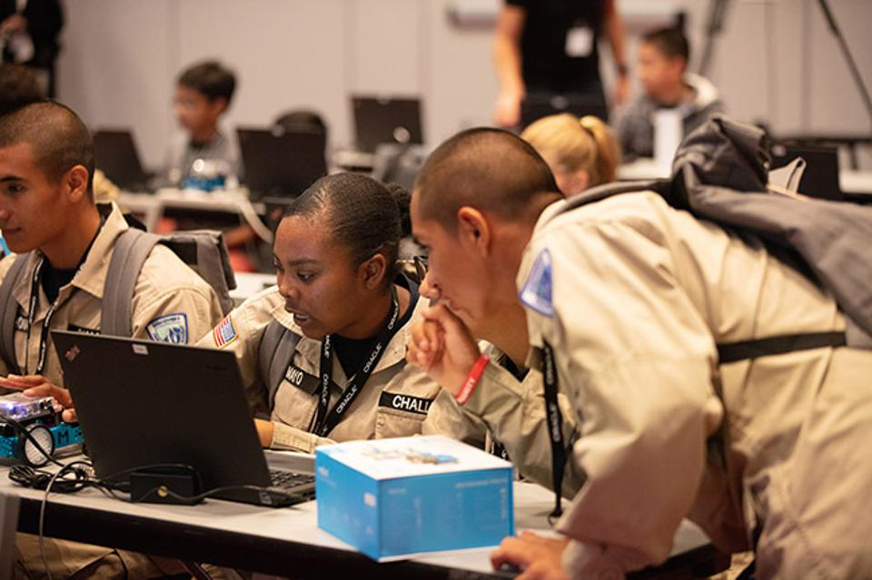 Students from Discovery ChalleNGe Academy, an alternative high school education partnership by the San Joaquin County Office of Education and the California National Guard, try programming at Oracle Code 4 Kids.