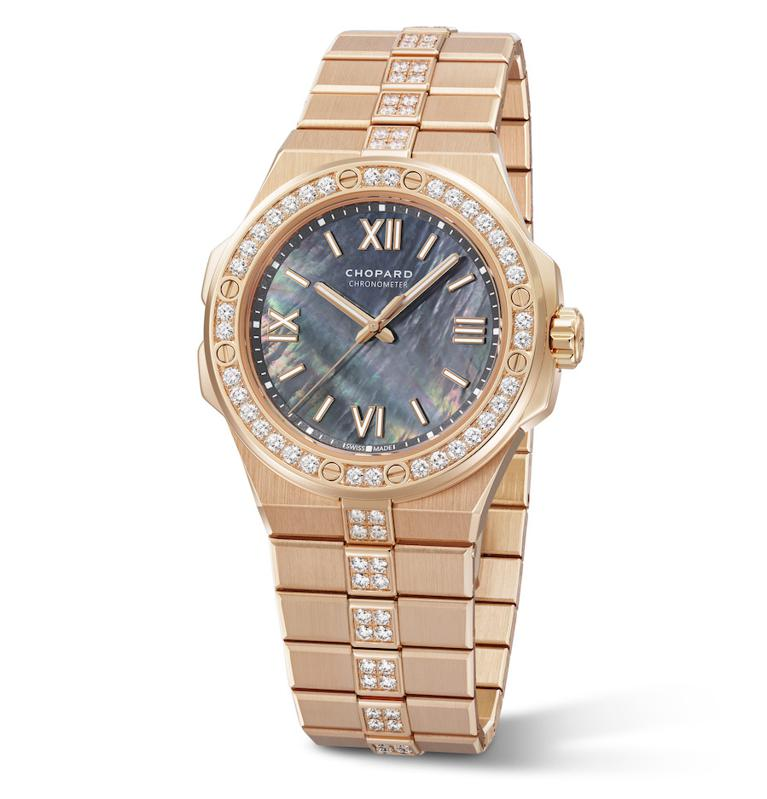 Beautiful gold case watch with embezzled diamonds around the face of the watch