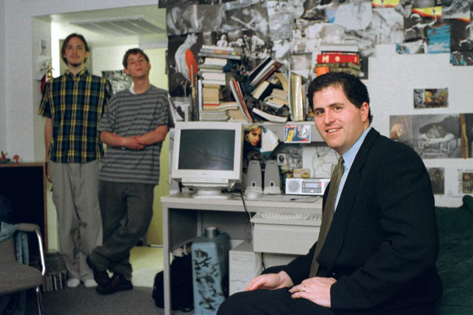 In this Friday, Feb. 26, 1999, file photo, Michael Dell, foreground, sits in the dorm room at the University of Texas in Austin, Texas, where he launched his enterprise as a college freshman.