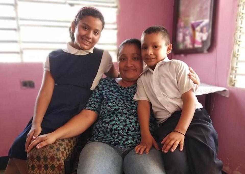 "Teacher Laura Albarrán at home with her children, 10-year-old Valeria and 8-year-old Manuel, in Maracaibo, Venezuela in September 2019. ""I work to see these children happy,"" says Albarrán."