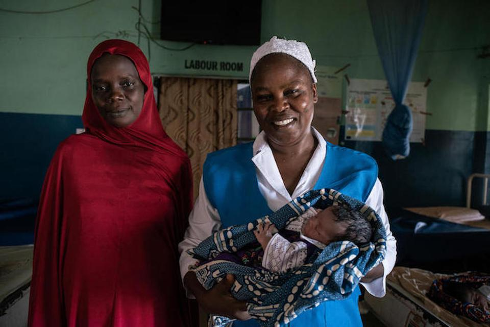 ″I want my baby to become a doctor when she grows up so that she can help women as they are helping us now,″ said 31-year-old Hajara Umar (left), standing with UNICEF-trained midwife Rahama Kadafa. ″She may change my life.″