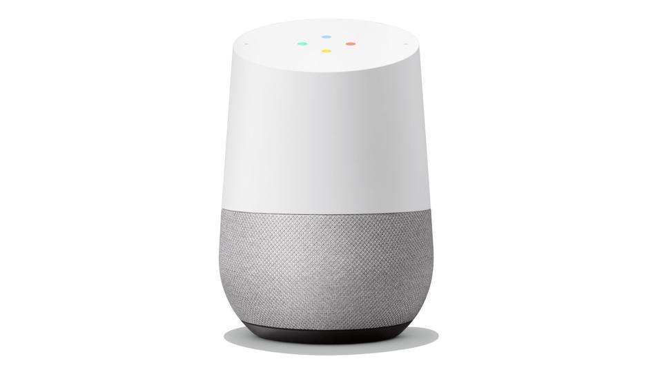 White Google Home smart speaker on a white background.