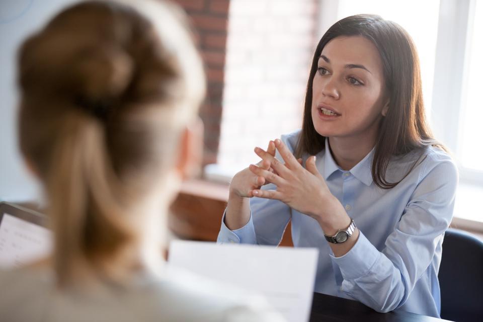 Women speaking at an MMI